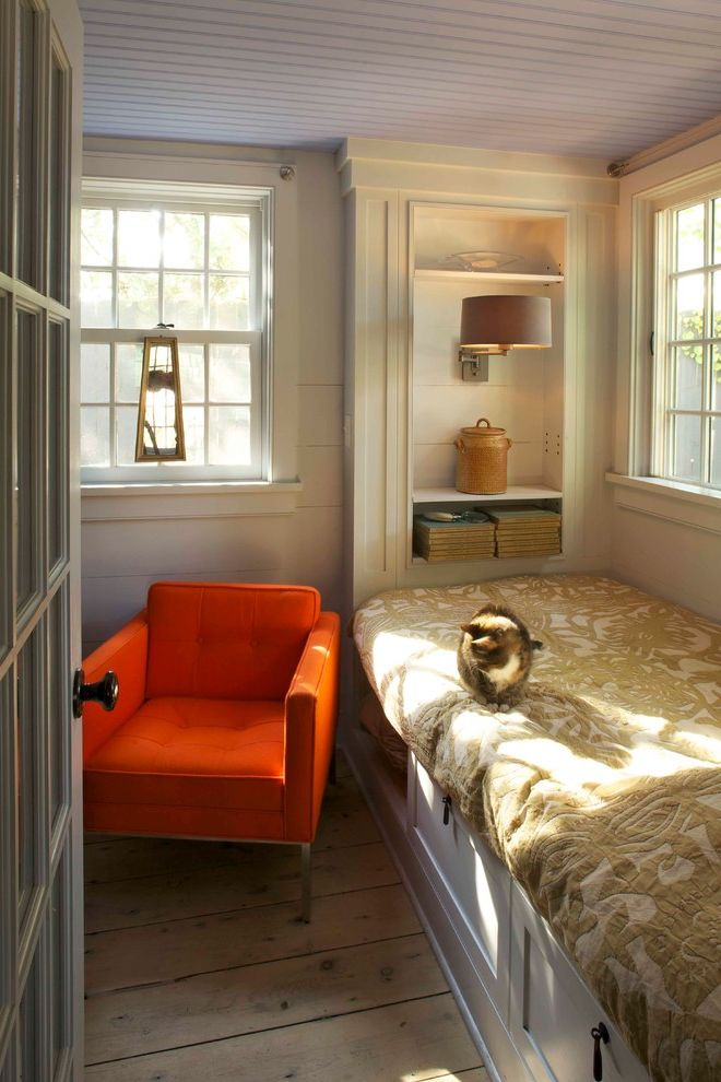 Small Armchair for Bedroom with Farmhouse Bedroom Also Beadboard Ceiling Bookshelves Built Ins Orange Armchair Rustic Wood Floor Window Seat Wood Floors