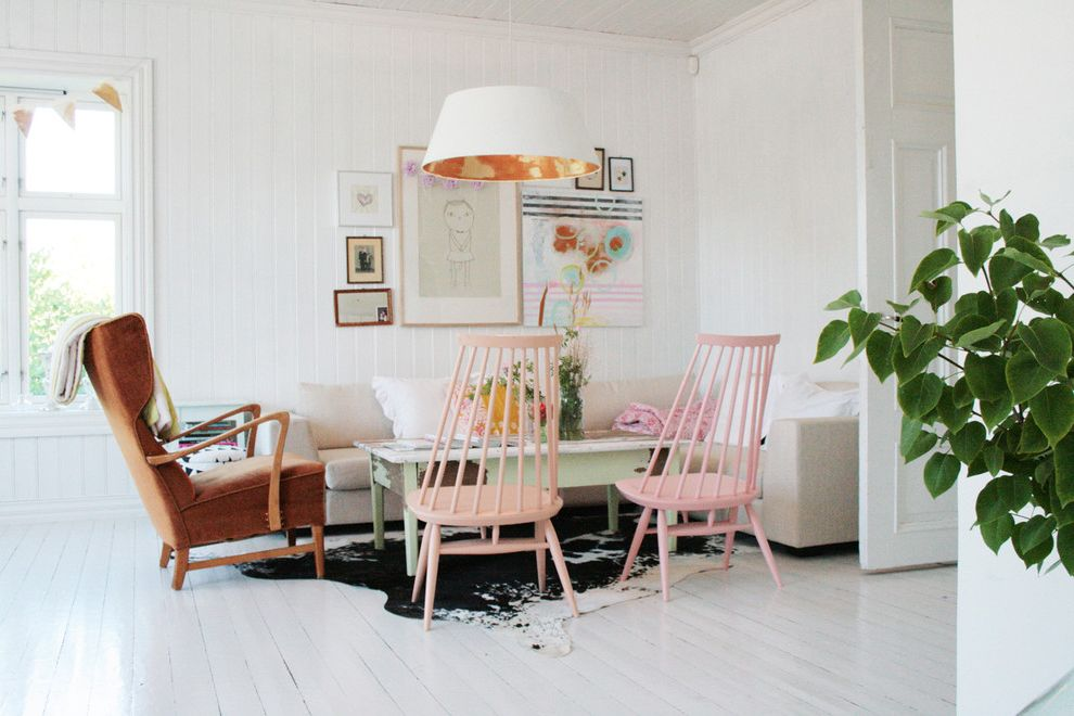 Small Leather Accent Chairs   Scandinavian Living Room  and Corner Sofa Cowhide Rug Painted Wood Pendant Lighting Pink Chairs Sectional Sofa Wall Art Wall Decor White Floor White Wood Wood Coffee Table Wood Flooring Wood Trim