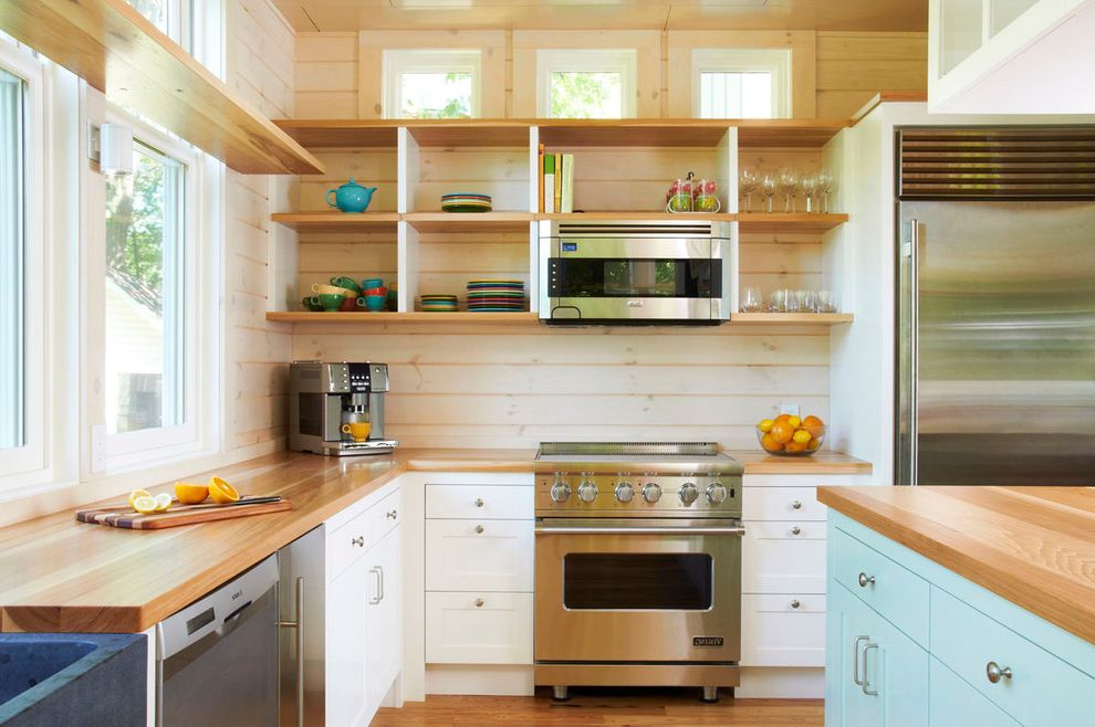 Small Over the Range Microwave with Traditional Kitchen  and Black Sink Bright China Knotty Pine Open Shelves Shaker Cabinets Stainless Refrigerator Tongue and Groove Wood Counters