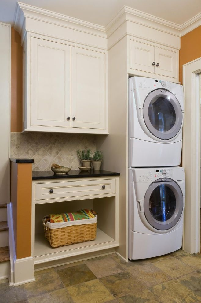 Small Stackable Washer and Dryer   Contemporary Laundry Room  and Built in Storage Front Loading Washer and Dryer Orange Walls Stackable Washer and Dryer Stacked Washer and Dryer Storage Baskets Tile Backsplash White Wood Wood Cabinets Wood Molding