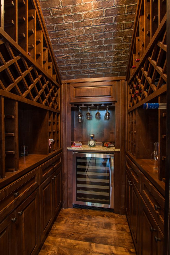 Small Wine Refrigerator   Traditional Wine Cellar  and Brick Ceiling Sloped Ceilings Vaulted Ceilings Walk in Wine Cellar Wine Racks Wine Refrigerator Wine Storage Wineglass Rack Wood Floors