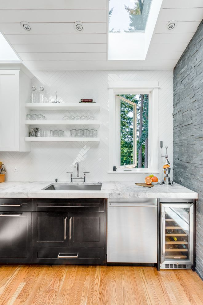 Small Wine Refrigerator with Transitional Kitchen  and Floating Shelves Herringbone Pattern Herringbone Tile Midcentury Modern Quartzite Quartzite Counters Skylight Slate Wall Stone Wall Thick Countertops White Tongue and Groove Wine Fridge