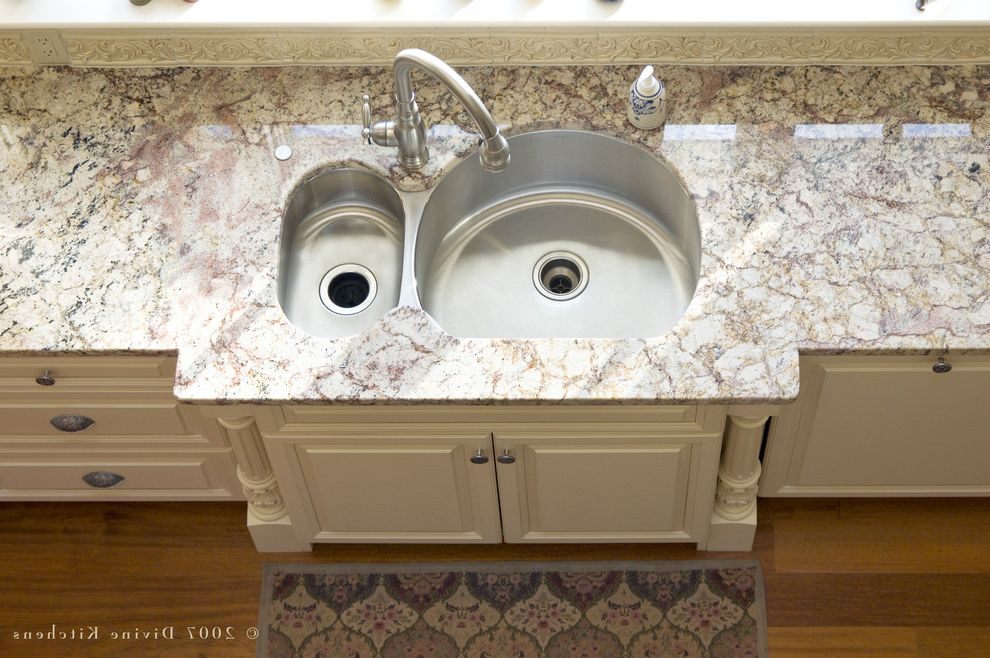 Smelly Garbage Disposal   Traditional Kitchen  and Built in Sink Double Sink Garbage Disposal Granite Countertop Hardwood Floor Painted Cabinets Stainless Steel Sink Storage White Cabinets White Countertop White Granite