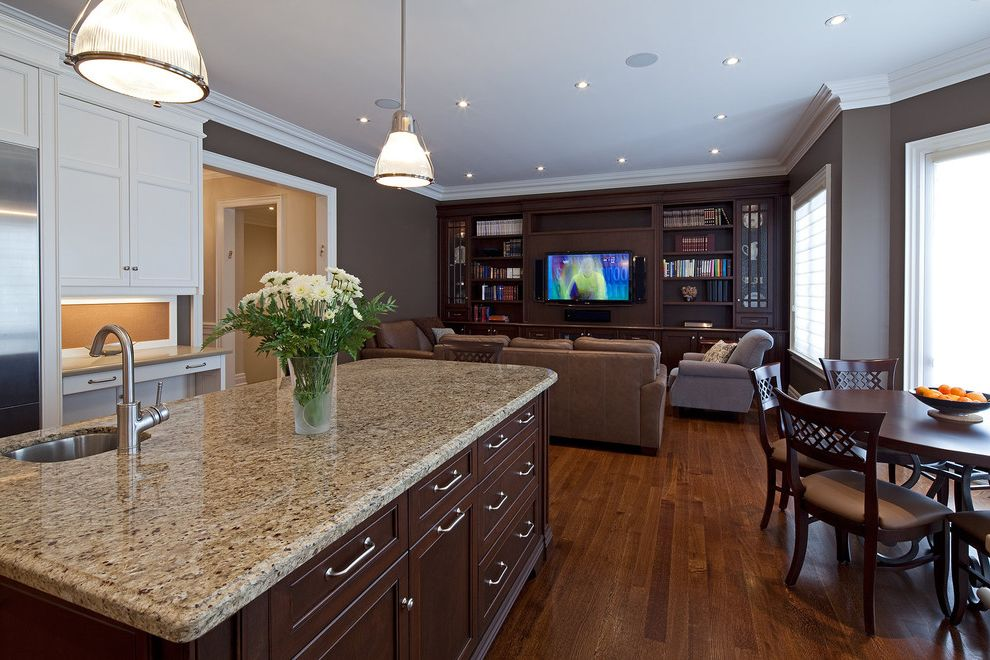Smoky Mountain Granite   Traditional Kitchen  and Cabinetry Dark Wood Dark Wood Floors Eat in Kitchen Entertainment Cabinet Glass Pendant Light Granite Kitchen Island Round Dining Table Speckled Tv Cabinet