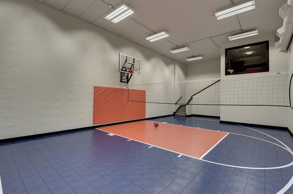 Snap on Flooring   Transitional Home Gym  and Basketball Court Basketball Key Basketball Standard Blue Floor Ceiling Lights Complementary Colors Hoop Orange Wall Pad Recreation Sport Court Stairs Volleyball Net