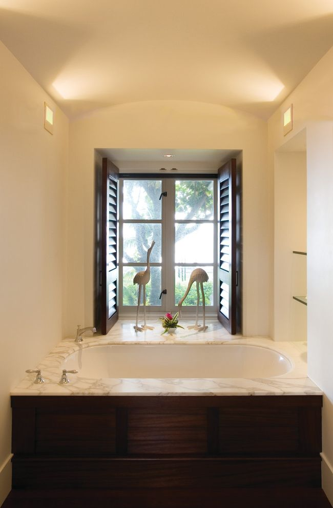 Soaker Tub Faucet with Contemporary Bathroom and Black Tub Built Ins Marble Surround Nook Sculptures Shelving Soaking Tub Statues Tub Surround Vaulted Ceiling View Wall Lighting Window Shutters Wood Shutters