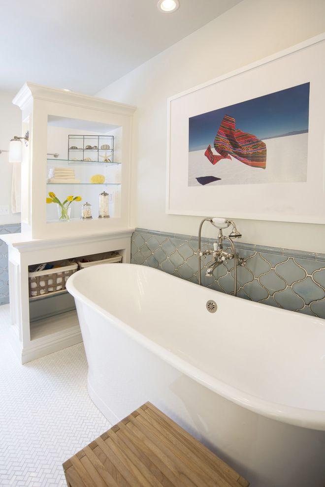 Soaker Tub Faucet with Mediterranean Bathroom and Arabesque Tile Framed Art Glass Shelves Herringbone Tile Open Shelves Tile Wainscot