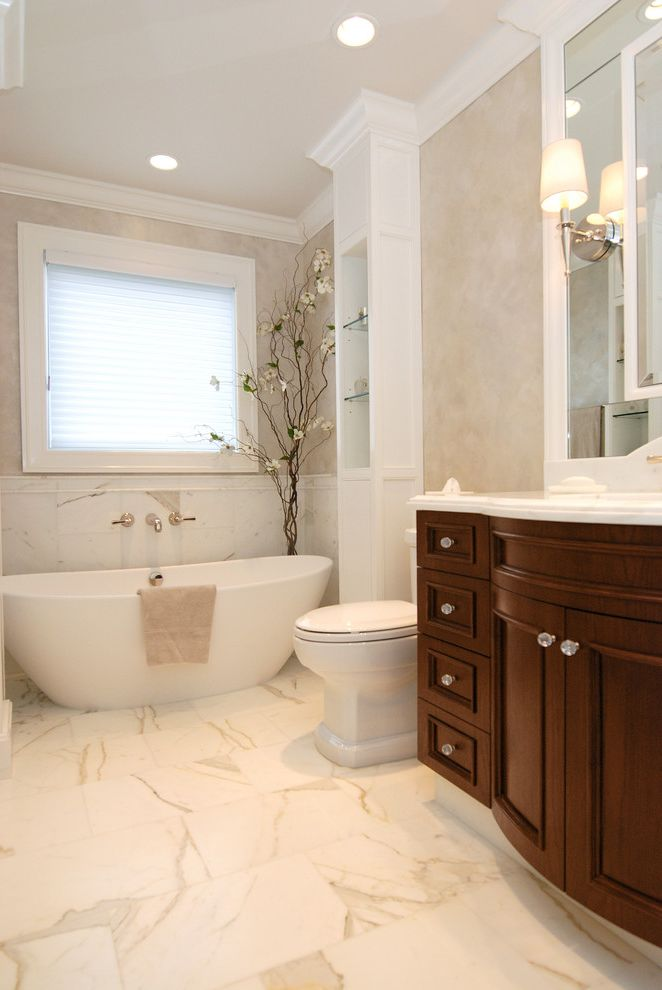 Soaker Tub Faucet with Traditional Bedroom and Crown Molding Curved Vanity Custom Cabinet Floor to Ceiling Decorative Hardware Floor Wall Tile Frame Mirror Freestanding Tub Marble Floor Wall Sconce