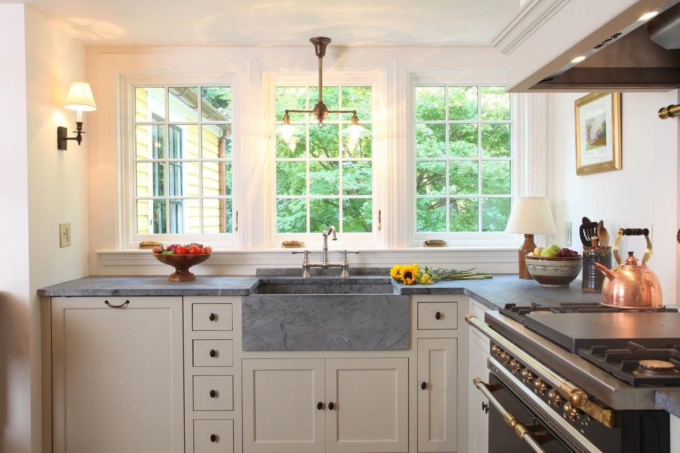 Soapstone vs Granite   Traditional Kitchen Also Apron Sink Farm Sink Gray Countertops Kitchen Windows Range Hood Sconce Shaker Cabinets Stone Sink Utensil Crock Wall Lighting White Kitchen White Trim