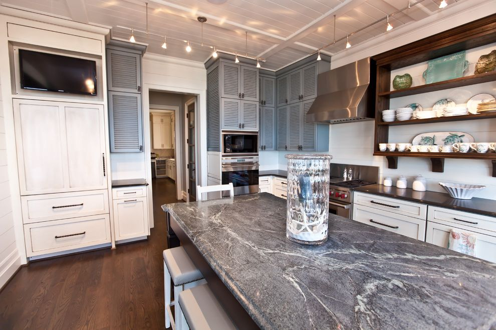 Soapstone vs Granite with Beach Style Kitchen Also Breakfast Bar Built in Ceiling Lighting Eat in Kitchen Island Kitchen Island Open Shelves Track Lighting Wood Floors