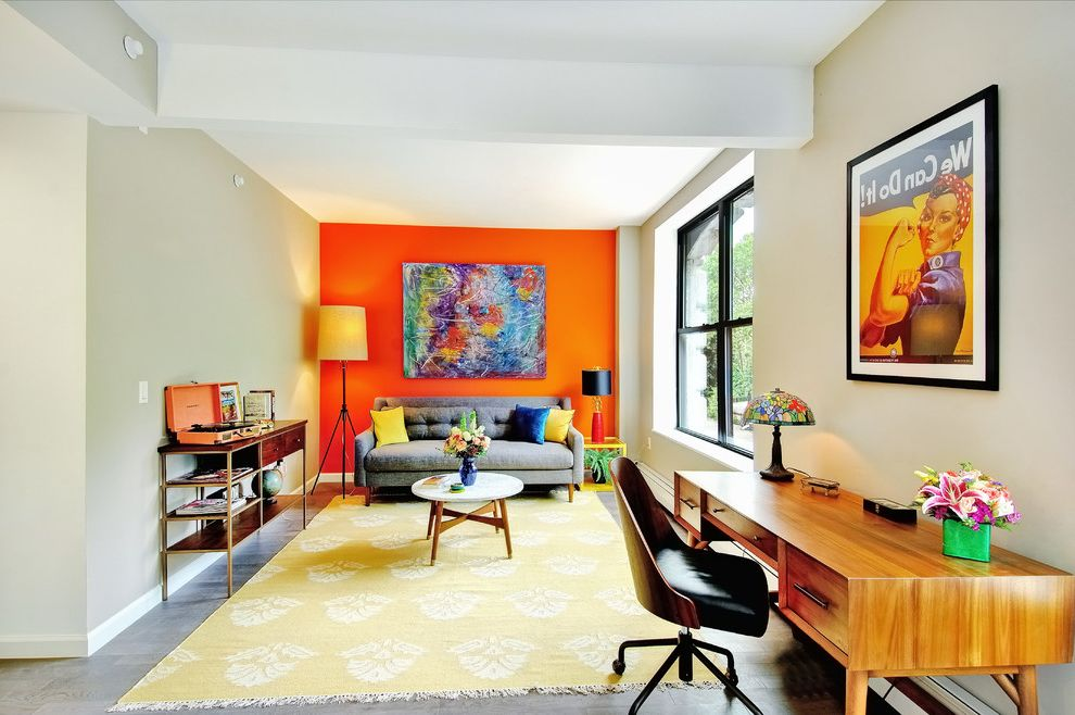 Sonoma Music Festival   Midcentury Living Room  and Black Framed Windows Coffee Table Colorful Accents Colorful Painting Floor Lamp Gray Sofa Orange Accent Wall Swivel Desk Chair Table Lamp We Can Do It Wooden Desk Yellow Area Rug Yellow Throw Pillows