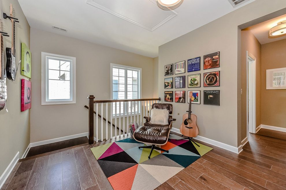 Sonoma Music Festival with Transitional Hall Also Colorful Rug Eames Chair Eames Leather Chair Fur Pillow Gallery Wall Gray Walls Guitar Loft Style Music Room Staircase Wood Floors Wood Railing