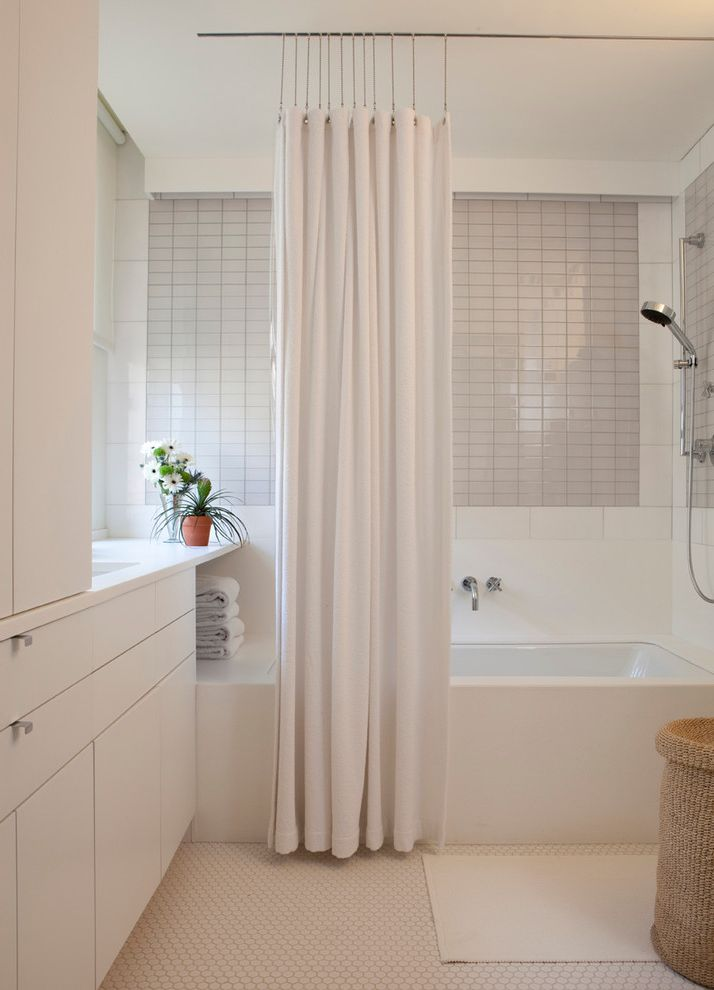 Sound Blocking Curtains   Contemporary Bathroom Also Basket Bath Mat Bathroom Storage Bathtub Built in Cabinetry Flowers Hamper Honeycomb Tile Floor Potted Plant Shower Curtain Thassos Towels Wall Mounted Faucet White Bathroom White Tile Wall