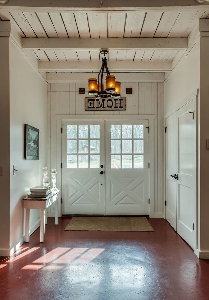 Southeastern Salvage Chattanooga   Farmhouse Entry  and Chandelier Exposed Beams Framed Artwork White Ceiling White Console Table Wood Ceiling