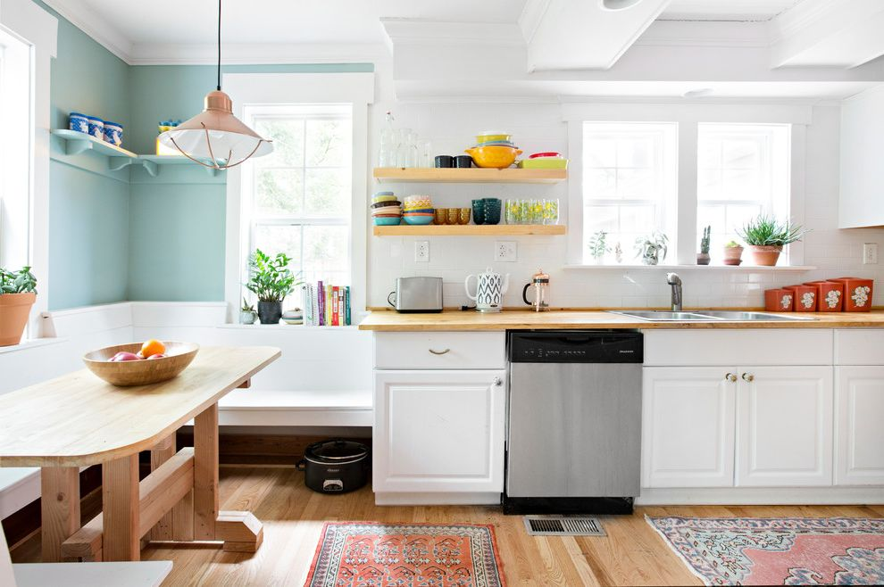 Southeastern Salvage Chattanooga with Farmhouse Kitchen Also Breakfast Nook Built in Bench Seat Colorful Kitchen Colorful Rug Copper Pendant Crown Molding Open Shelving Turquoise Walls Wraparound Bench Seat