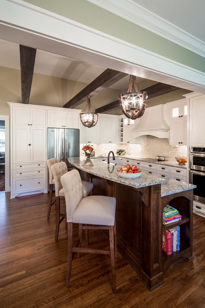 Southern Lights Mn   Transitional Kitchen  and Beige Walls Custom Hood Dark Stained Wood Island Pendants Kitchen Island Pendant Lights Quartz Recessed Panel Millwork Upholstered Bar Stools White Cabinets White Hood Wood Beams Wood Floor