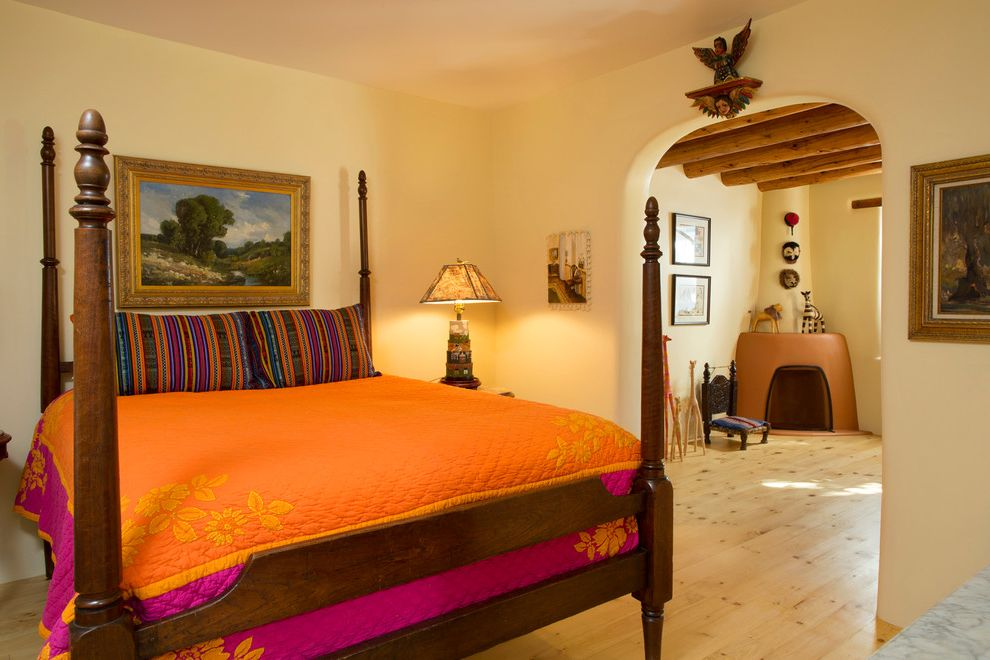 Southwest Bedspreads   Southwestern Bedroom  and Archway Bedroom Corner Fireplace Four Poster Bed Historic Preservation Orange Bedding Southwestern Style Striped Pillows Wood Bed Wood Floors