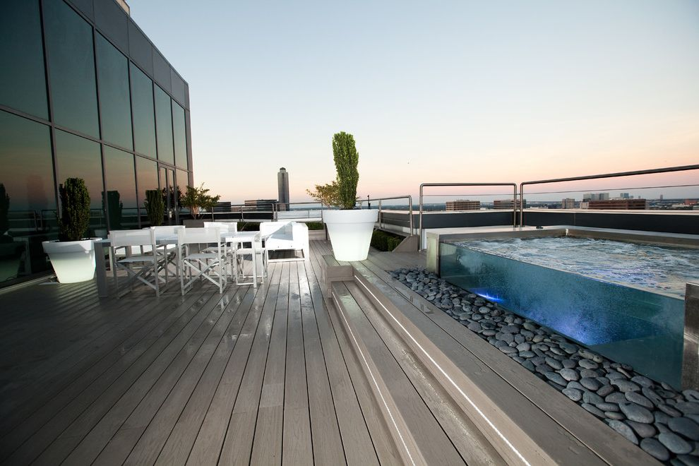 Spa at River Ridge   Contemporary Deck Also Balcony Deck Directors Chair Glowing Pots Hot Tub Modern Outdoor Furniture Potted Plant Roof Deck Spa Stones Terrace White Chair White Table