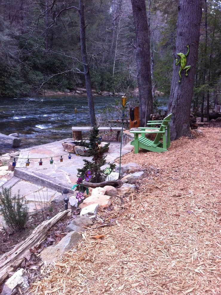 Spa at River Ridge   Eclectic Landscape Also Adirondack Chairs Bark Mulch Fire Pit Flagstone Patio Green Landscaping Outdoor Fireplace Retaining Wall River River Bank Rock Wall Stone Bench Stone Wall Water View