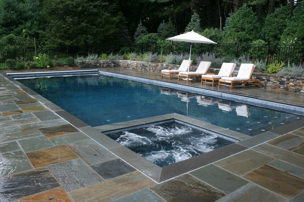 Spa at River Ridge with Traditional Pool  and Chaise Lounge Hot Tub Integrated Spa Jacuzzi Outdoor Cushions Patio Furniture Patio Umbrella Pavers Planter Pool Deck Spa Stone Paving Stone Wall