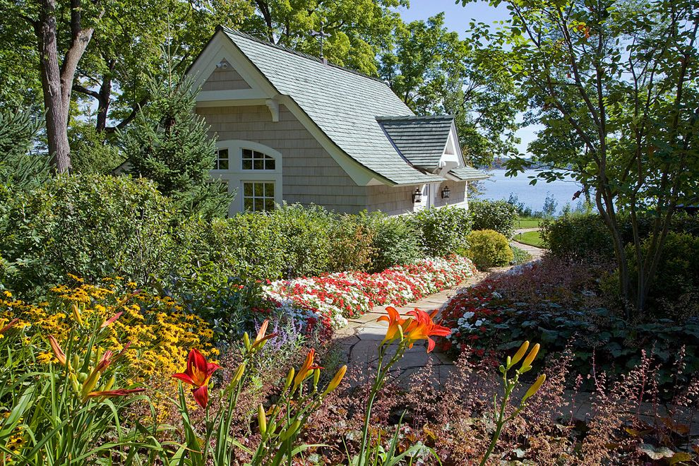 Spas in Lake Geneva Wi   Traditional Landscape  and Annuals Arched Window Cedar Shake Colorful Corbels Covered Entry Dormer Flagstone Path Flower Beds Gable Roof Lake View Lanterns Perennials Shingle Siding Sloped Roof Vanzelst Winding Walkway