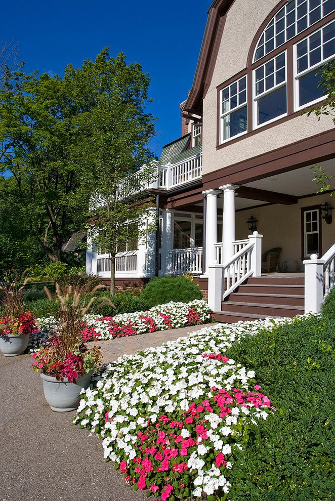 Spas in Lake Geneva Wi with Traditional Landscape Also Arched Window Barn Roof Brown Trim Colorful Flower Bed Flower Pots Gambrel Planting Beds Porch Steps Tapered Column Vanzelst White Railing