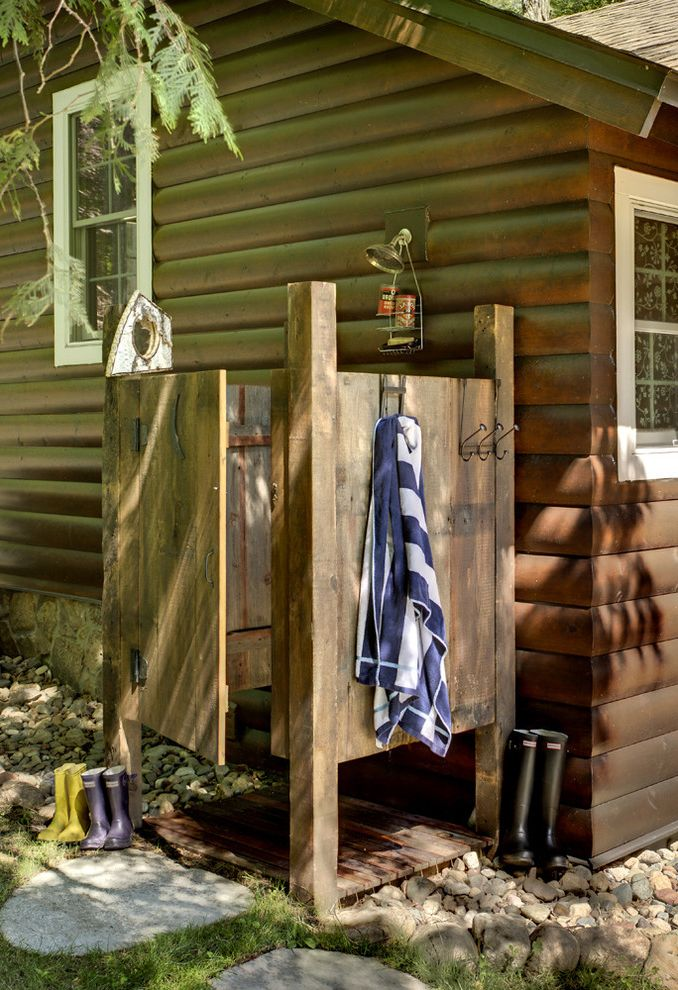 Speakman Outdoor Shower with Rustic Patio  and Cabin Camp Landscape Log Cabin Outdoor Shower Outdoor Shower Head Rainboots Rustic Shower Caddy Stone Steps Towel Rack Wood Shower Wood Siding