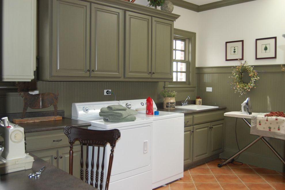 Speed Queen Top Loader   Traditional Laundry Room  and Beadboard Cabinetry Chicago Interior Designer Chicago Laundry Room Design Green Laundry Room Ironing Board Laundry Room Molding Sage Green Sewing Table Sink Tile Floor White Appliances