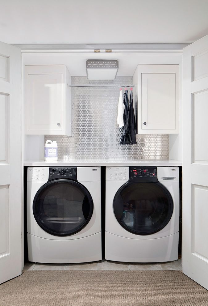 Speed Queen Top Loader with Transitional Laundry Room Also Clothes Rail Metallic Tile Backsplash Washer Dryer Closet White Cabinets White Closet Doors White Counter