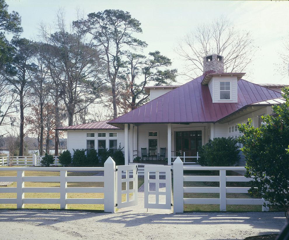 Split Rail Fence Cost with Farmhouse Exterior  and Brick Chimney Dormer Windows Entrance Entry Equestrian Fence Front Door Grass Lawn Metal Roof Porch Red Roof Rocking Chair Split Rail Fence Turf White Wood Wood Fencing Wood Gate Wood Post Wood Siding