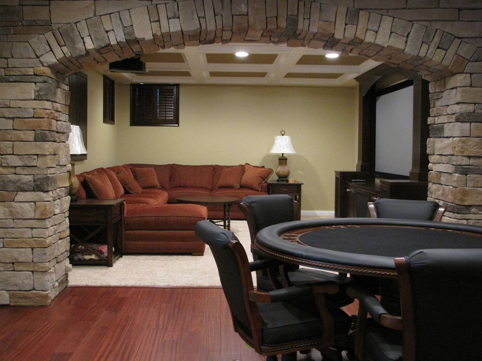 Spokane Valley Theater with Traditional Home Theater  and Arch Basement Coffered Ceiling Custom Shutters Entertainment Center Family Room Hardwood Flooring Man Cave Media Room Poker Table Stone Archway Theater Tv Cabinet