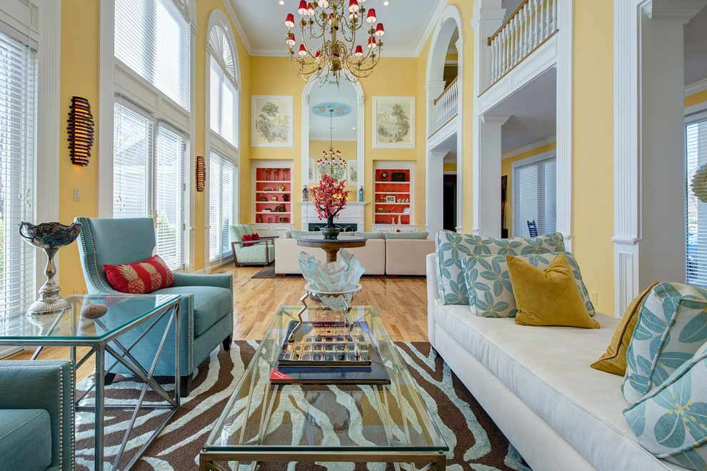 St Louis Furniture Stores   Contemporary Living Room  and Arched Openings Balcony Blue Bright Built in Shelves Chandelier Day Bed Fireplace Light Nail Head Detail Open Railing Red Seating Area Settee Velvet Wing Chairs Yellow Zebra Rug Glass Coffee Table