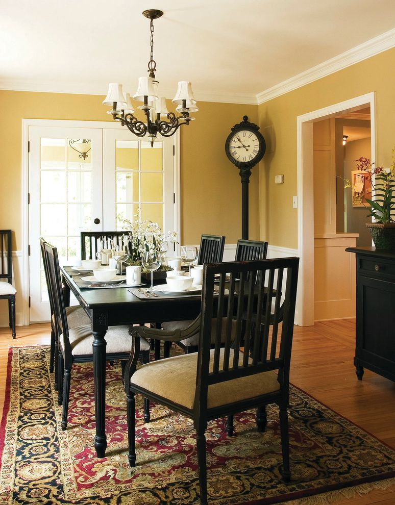 St Louis Furniture Stores with Traditional Dining Room  and Black Chair Black Dining Table Chandelier Clock Dining Chair Dining Table Formal Dining French Doors Molding Oriental Carpet Painted Wall Rug Table Setting Wainscoting Wood Floor Yellow Wall