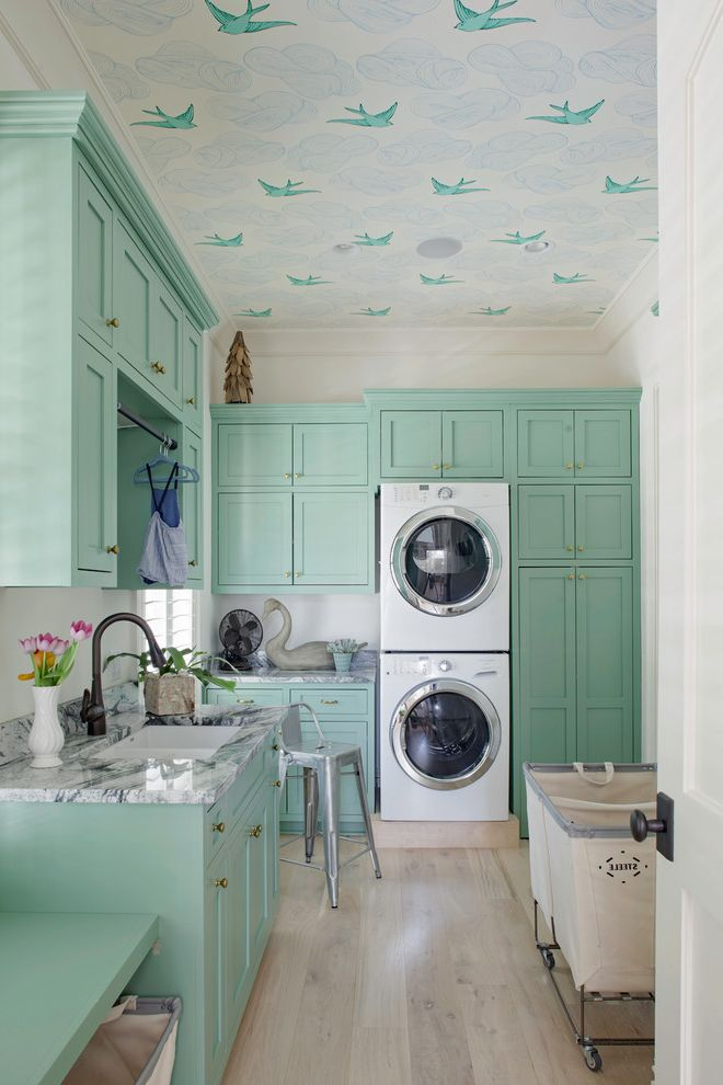 Stacking Paper Trays   Transitional Laundry Room Also Built in Cabinetry Hampers Hanging Rod Lots of Storage Metal Counter Stool Mint Green Wallpaper on Ceiling White Appliances