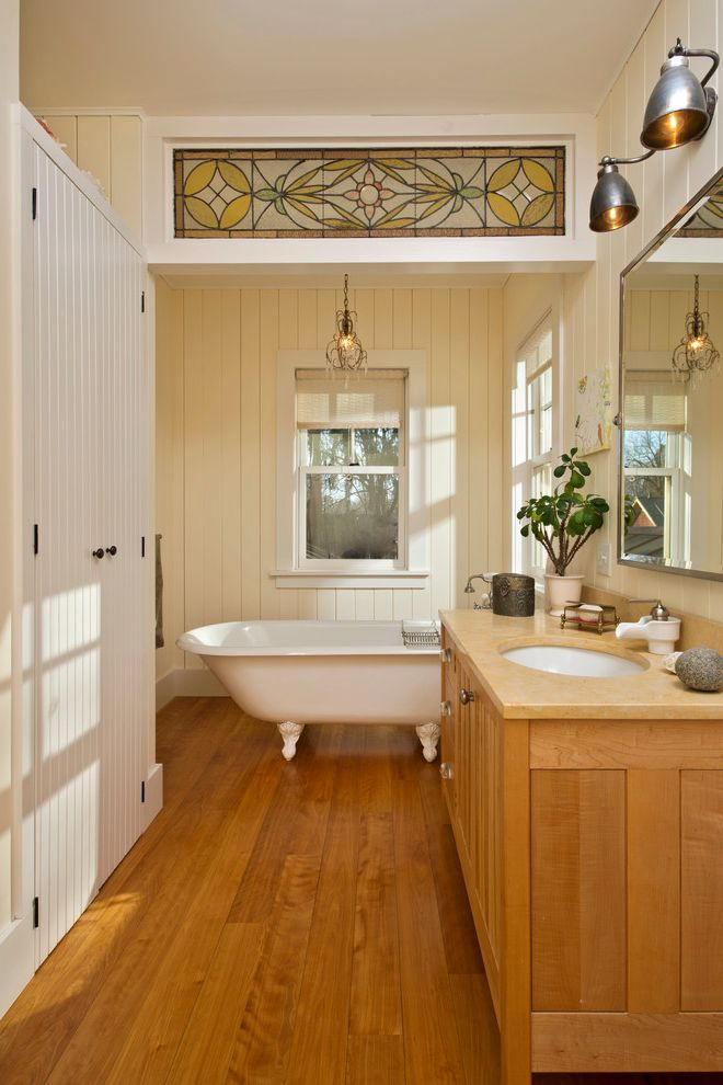 Stained Glass Evanston with Farmhouse Bathroom  and Bath Tub Bathroom Chandelier Beige Wall Claw Foot Tub Clawfoot Tub Stained Glass Wall Sconce White Armoire White Cabinets Wood Cabinets Wood Floor Wood Panel Wall Wood Paneling