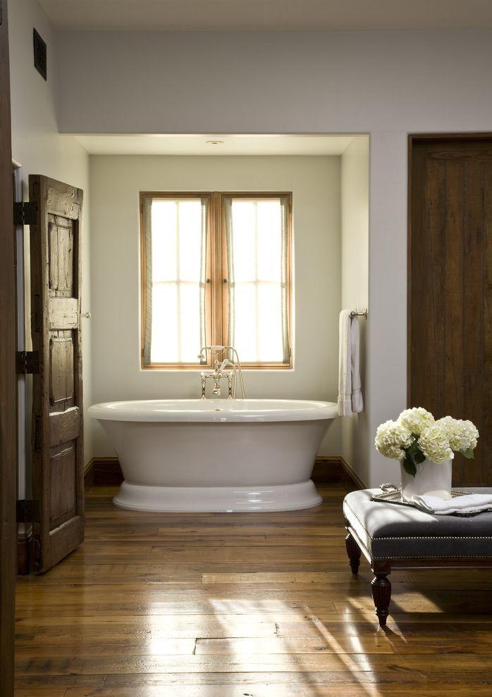 Stand Alone Dishwasher with Traditional Bathroom  and Dark Wood Door Dark Wood Floors Freestanding Tub Nailhead Ottoman Pedestal Tub Rustic Door Soaking Tub White Walls