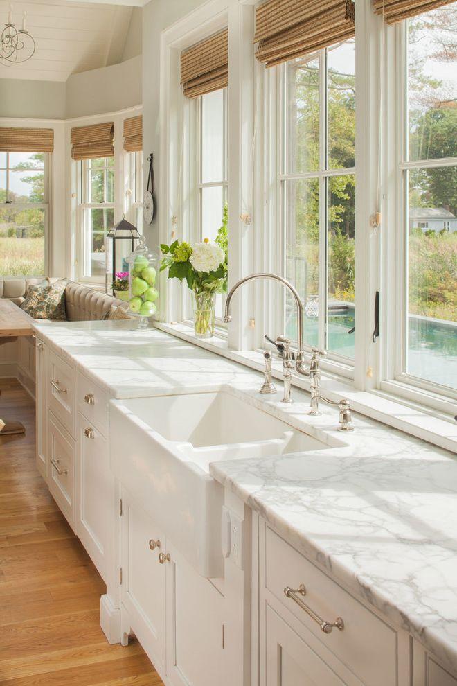 Stand Alone Kitchen Sink with Beach Style Kitchen and Beach Home Bright Kitchen Calacatta Gold Coastal Home Kitchen Countertops Marble Countertops Natural Light Natural Stone Countertop White Kitchen Windows