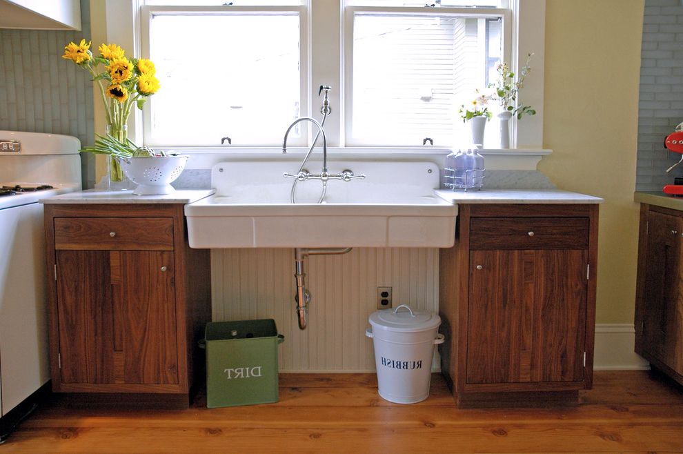 Stand Alone Kitchen Sink with Traditional Kitchen and Apron Front Sink Apron Sink Beadboard Colander Dirt Bin Farmhouse Sink Fir Floors Metal Bins Rubbish Bin Tile Backsplash Vintage Stove Walnut Cabinets Wood Floor Yellow Wall