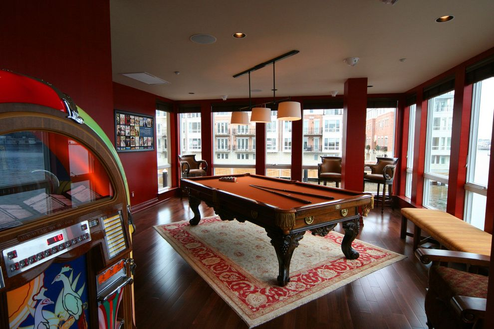 Standard Pool Table Size with Eclectic Family Room Also Area Rug Billiards Ceiling Lighting Dark Floor Game Room Juke Box Oriental Rug Pool Table Recessed Lighting Red Walls Wood Flooring Wood Trim