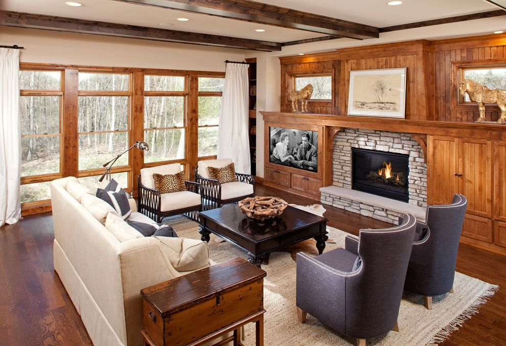 Standard Tv and Appliance Beaverton   Traditional Family Room Also Beam Built in Shelves Cream Sofa Horse Large Window Leopard Pillows Mantel Stone Fireplace Trunk