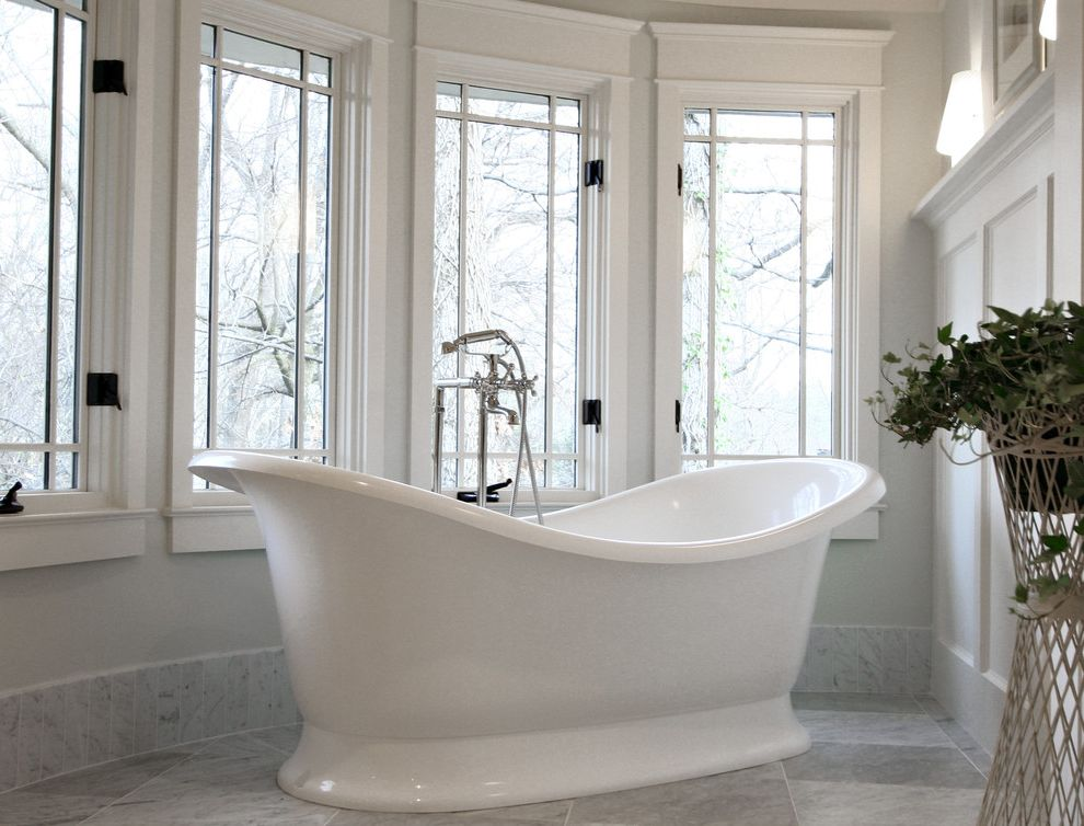 Standard Window Width   Traditional Bathroom  and Casement Windows Freestanding Bathtub Marble Flooring Marble Tile Neutral Colors Tile Flooring Wainscoting White Wood Wood Trim