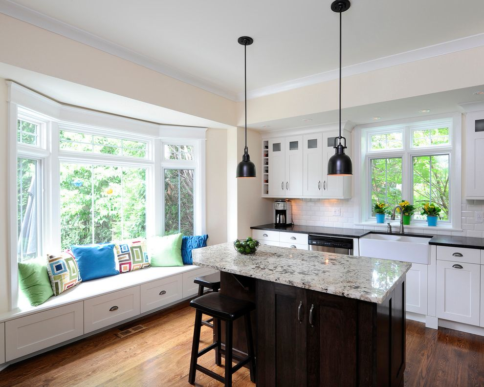 Standard Window Width with Traditional Kitchen  and Bay Window Bin Pulls Black Counters Farmhouse Sink Glass Cabinet Granite Counter Shaker Cabinets Small Kitchen Island Subway Tile Transom White Cabinets Window Seat