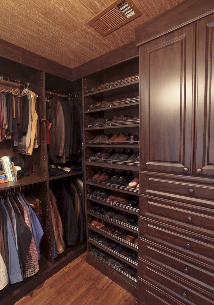 Standing Closet Rack   Traditional Closet Also Dark Wood Cabinets Hanging Rods Hardwood Floor Shoe Shelves Shoe Storage Walk in Closet Wardrobe Wood Ceiling