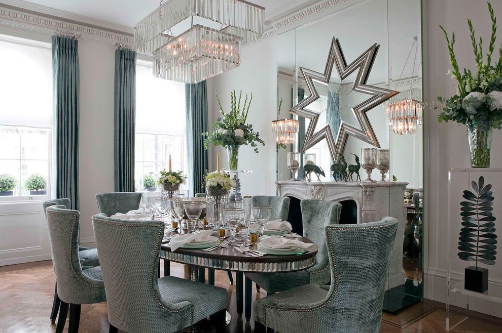 Star Pointe Realty with Contemporary Dining Room Also Blue Crown Molding Curtains Dining Chairs Dining Table Fireplace Mirror Fireplace Surround Modern Chandelier Upholstered Chairs Wood Floors