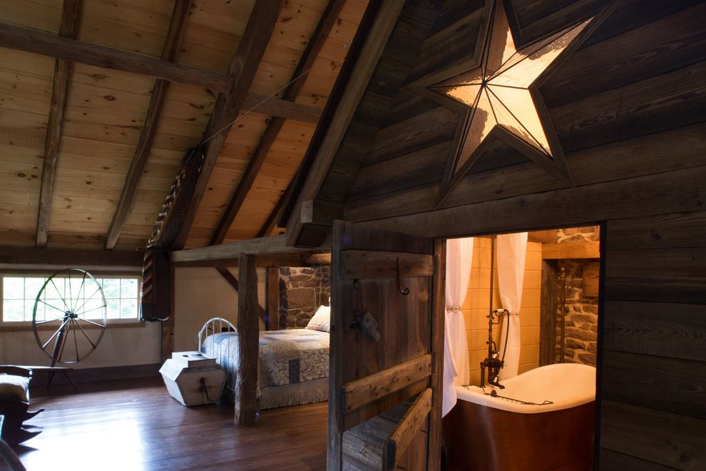 Star Pointe Realty with Farmhouse Bedroom Also Barn Barn Door Bathroom Bed en Suite Freestanding Bath Post and Beam Rustic Modern Sloped Ceiling Star Wood Floors Wood Paneling