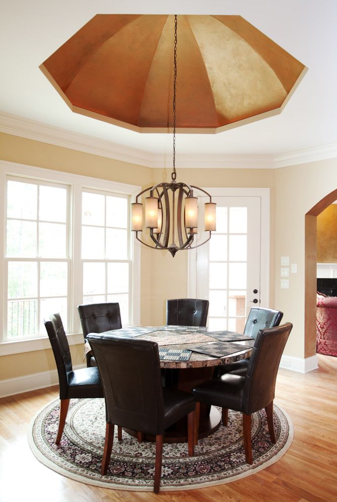 Star Shaped Light Fixture   Traditional Dining Room  and Atlanta Beige Walls Black Leather Chairs Cablik Ceiling Detail Circular Area Rug Custom Home Dining Room Dining Room Chandelier Gold Raised Ceiling Light Wood Floors White Trim