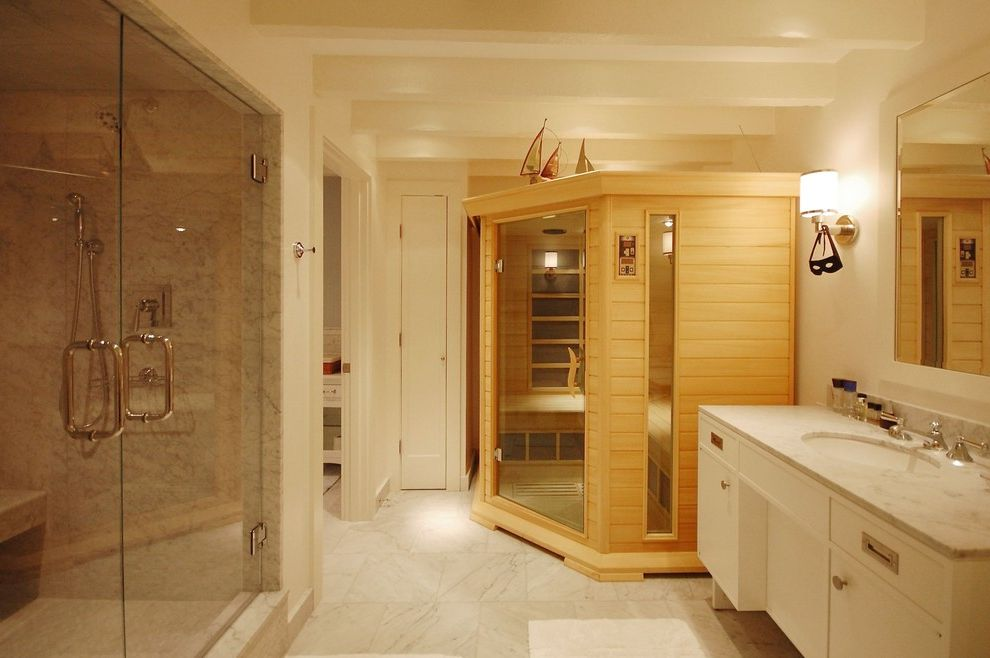 Steam Room vs Sauna   Beach Style Bathroom  and Exposed Beams Glass Shower Doors Marble Marble Countertops Neutral Colors Sauna Sconce Tile Flooring Vanity Wall Lighting White White Bathroom
