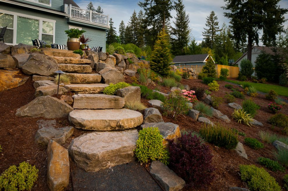 Stepping Stone Round Rock with Traditional Landscape  and 14 Minus Gravel Walkway Arbors Trellis Bushes Hillside Hillside Landscape Landscaping Mulch Landscape Outdoor Potted Plant Pergolas Pink Flowers Shrubs Stone Stairs Stone Steps Stone Walkway