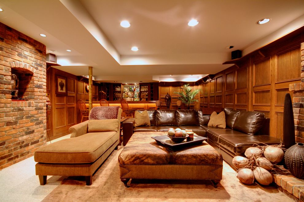 Stickley Furniture Prices with Eclectic Basement Also Area Rug Brick Walls Ceiling Lighting Chaise Lounge Earth Tone Colors Home Bar Leather Sofa Nailhead Trim Recessed Lighting Sectional Sofa Tray Ceiling Upholstered Ottoman Wood Paneling