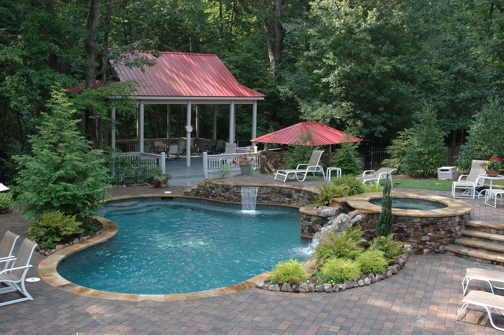 Still Waters Resort Branson Mo with Traditional Pool  and Brick Paving Custom Freeform Pool Forest Hot Tub Metal Roof Natural Landscape Naturalistic Pool Cabana Pool House Pool Landscape Red Roof Spa Split Level Patio Waterfall